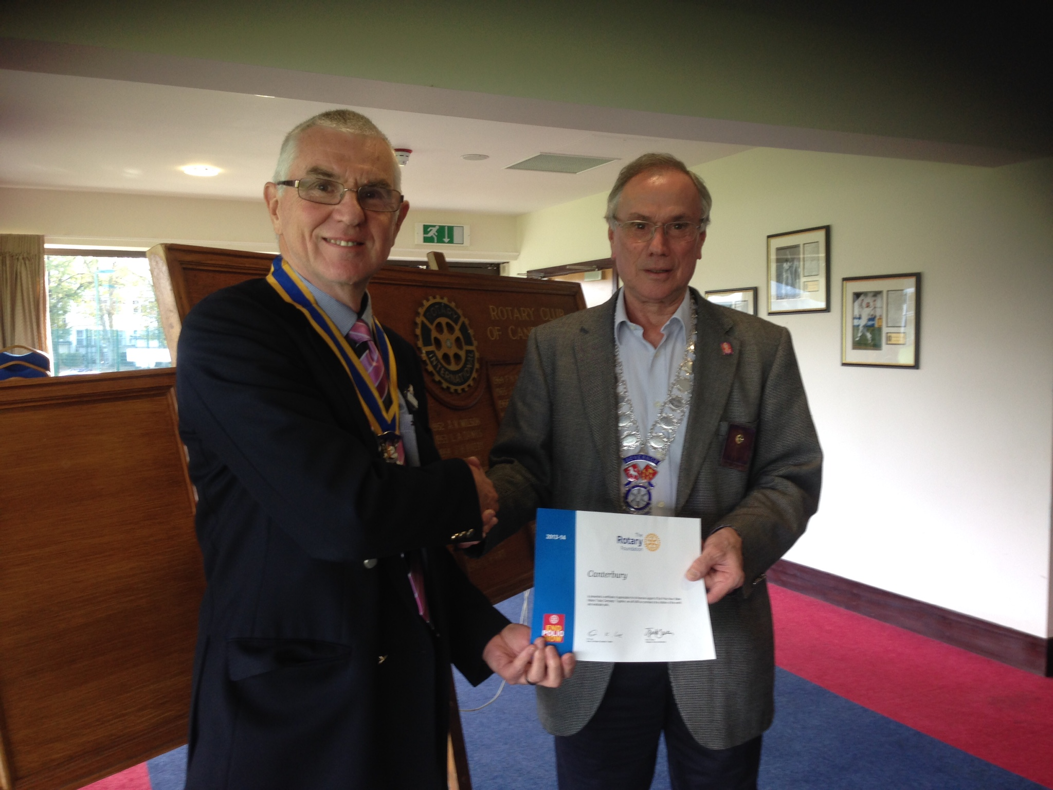 District Governor Martin Williams presents a Certificate to President Viv