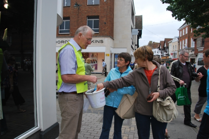 A volunteer Rotarian collecting from members of the public in the High Steret
