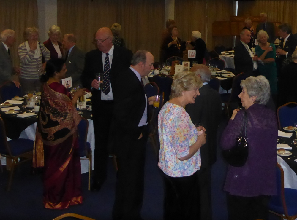 Guests enjoying a pre-meal drink and chat