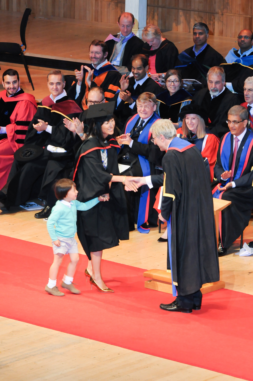 Saya receives her MBA