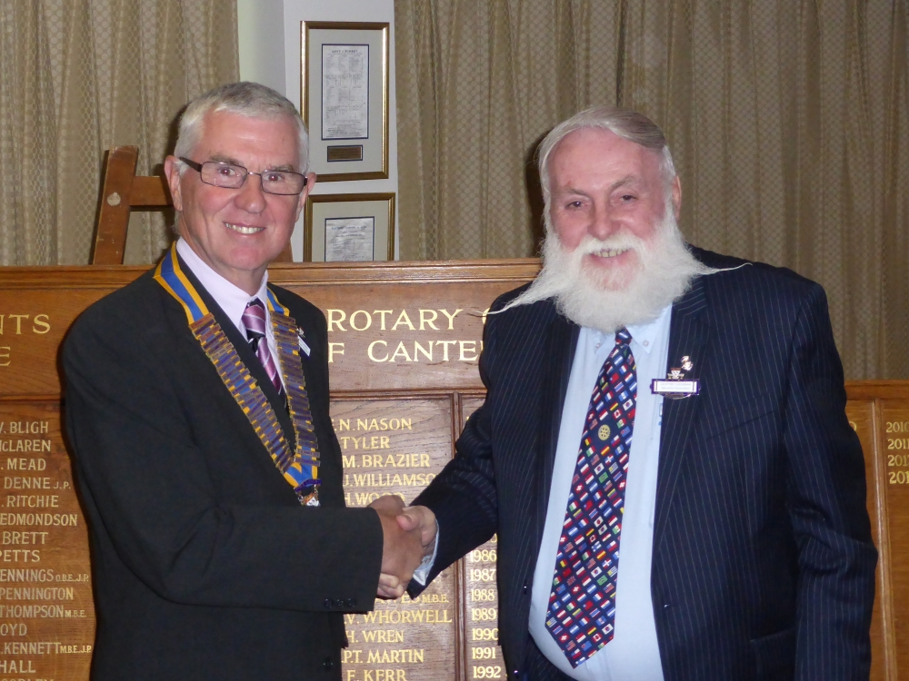 New President Viv is congratulated by Past President Geoff