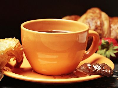 Coffee cup and croissants