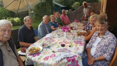 Members of the Committee enjoying their meal, hosted by Sidney and Evelyne Denham.