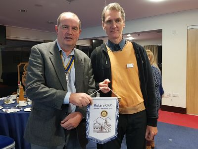 Ulrich presents our President Martin with a pennant at our evening meeting
