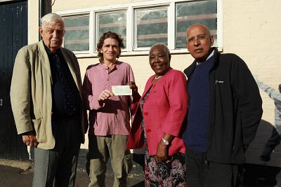 Handing cheque over to Catching Lives