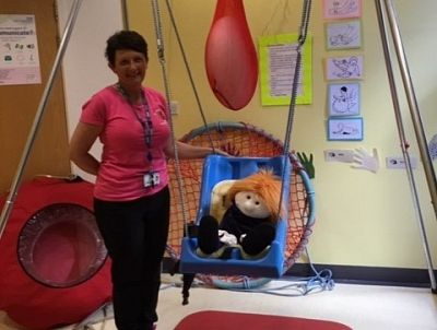 Jane Flockhart, Manager of the Nursery, pictured with the swing.