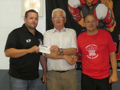 Peter Hermitage hands over the cheque to  Joey Wicks and Kevin Place