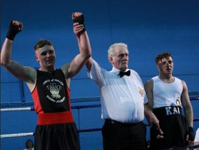 Referee Geoff Cannell with two of the young boxers.