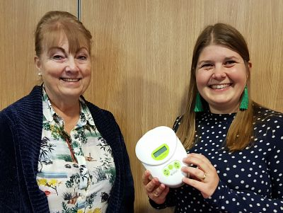 Lyn and Hannah hold a breastpump at our meeting