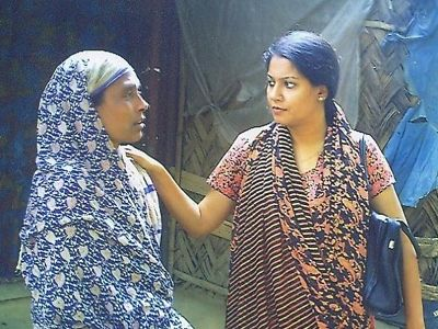 Rizwana comforts the mother of an eighteen-year old who had lost his life while working at a shipbreaking yard