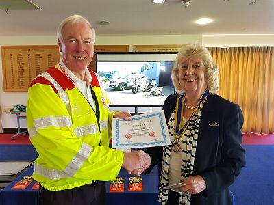 Trevor Sayer from SERV Kent hands a certificate of thanks to President Margaret Griffin