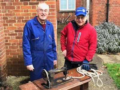 Richard happily delivers the treadle machine to John Barton from the TFSR workshop.