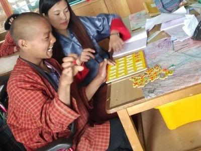Special needs teacher Tshering Dolkar assists a student at the school.