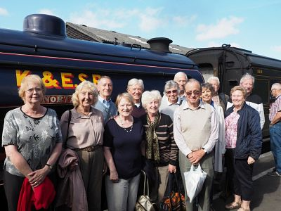 Club members pose for a photo beside one of Kent & East Sussex Railway